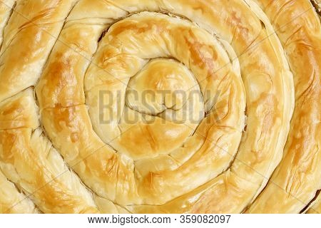 Close Up Of Baked Filo Pastry Pie In Spiral Shape
