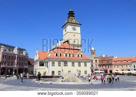 Brasov, Romania - August 21, 2012: People Visit Sfatului Square In Brasov, Romania. Brasov Is The 7t