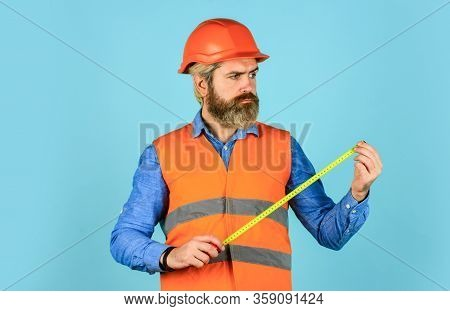 Worker Use Tape Measure. Size Concept. Hipster In Hard Hat. Make Measurements Apartment Renovation.
