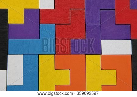 Abstract, Background With Different Colorful Shapes Of Wooden Blocks. Geometric Shapes In Different