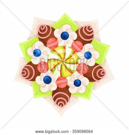 Bouquet Of Sweets Chocolate And Caramel Covered With Striped Candies In Paper Wrap View From Above V