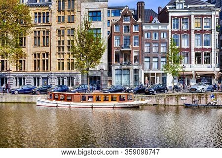 Amsterdam, The Netherlands  - 7 May, 2017, People Having Rest And Relaxing In Amsterdam In The Nethe
