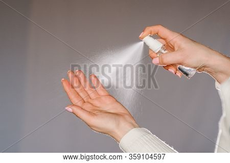 Hands Applying Alcohol Spray Or Anti Bacteria Spray. Personal Hygiene Concept. Coronavirus. Cleaning