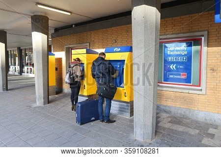 Eindhoven, Netherlands - November 19, 2016: Passengers Buy Tickets With Chip Card At Railway Station