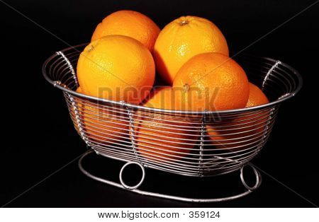 Oranges In A Wire Bowl
