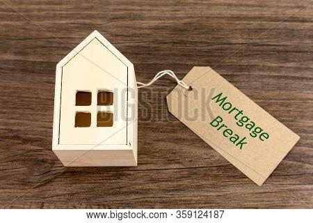 Mortgage Break - Toy Wooden House Alongside Label Which Reads Mortgage Break