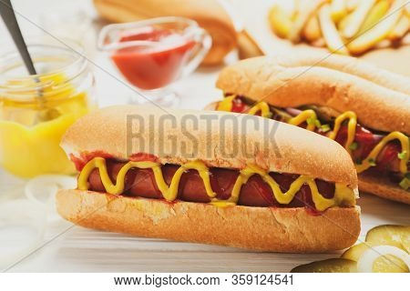 Hot Dogs, Fries Potato And Sauces On White Wooden Background
