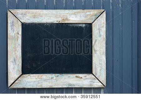 Vintage Blackboard On A Wooden Wall