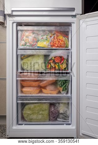 Opened Freezer Refrigerator With Frozen Vegetables And Meat. Freezed Food Supplies Crisis, Food Stoc