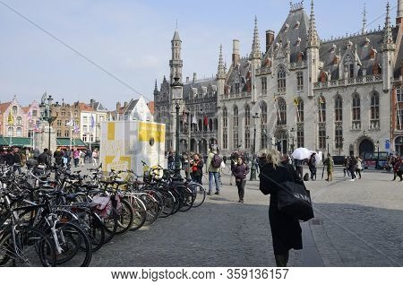 Brugge, Belgium - March 31, 2019: People At The  Market Square With The Province Court At The Backgr