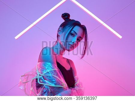 Elegant Beautiful Woman In A Raincoat Around Colourful Bright Neon