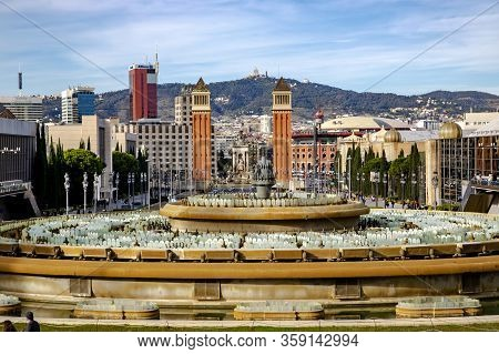 Spain, Barcelona, December, 2017 - Spain Square Overlooking The Famous Fountain And Two Venetian Tow