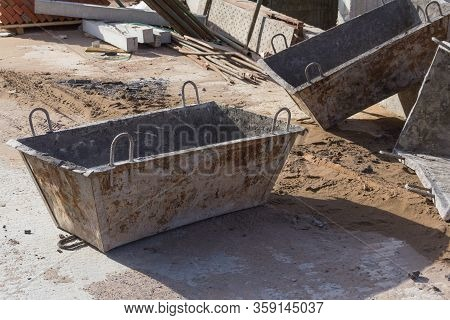 Construction Concrete Bucket. Tanks For Transportation Of Concrete Mix On A Building Site. Concrete