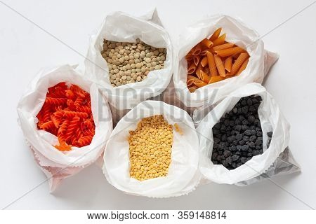 Legumes. Legume Paste In Paper Bags On White Background. Red, Yellow Lentil Paste Green, Yellow Lent