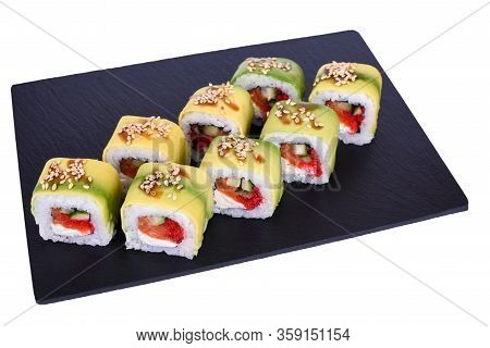 Traditional Fresh Japanese Sushi Rolls On A Black Stone Green Dragon On A White Background. Roll Ing