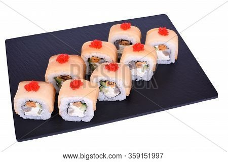 Traditional Fresh Japanese Sushi Rolls On A Black Stone Mikado On A White Background. Roll Ingredien