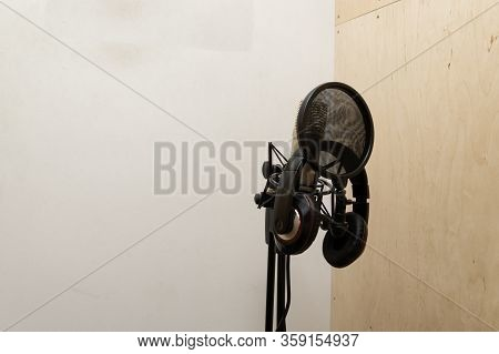 A Booth For Recording Sound. Microphone And Headphones For Recording. Listening And Recording.