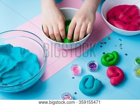 Child Hands Playing With Colorful Clay. Homemade Plastiline. Plasticine. Play Dough. Girl Molding Mo