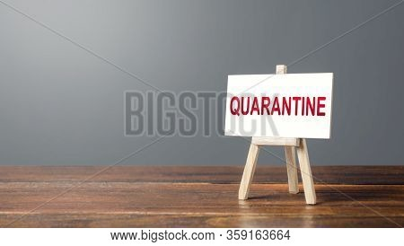 Easel With A Word Quarantine. Tough Measures To Stop New Infections Of Coronavirus Covid-19 Exponent