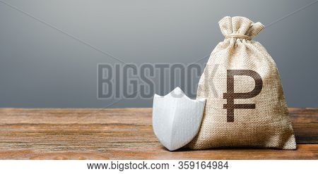 Russian Ruble Money Bag And Protection Shield. Ease Doing Business. Protection Of Foreign Investment