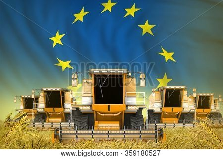 A Lot Of Yellow Farming Combine Harvesters On Farm Field With European Union Flag Background - Front