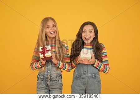 Thankful For Every Gift Of Fate. Teaching Kids Be Thankful. Children Hold Gift Boxes Yellow Backgrou