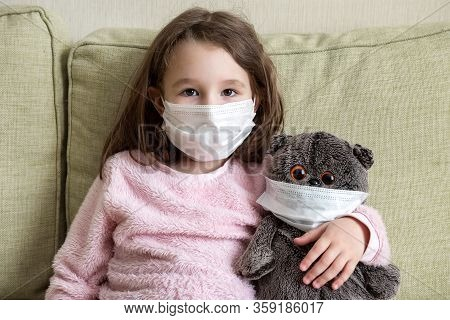 Stay At Home In Quarantine, Funny Kid With Toy On Couch During Covid-19 Coronavirus Pandemic. Little