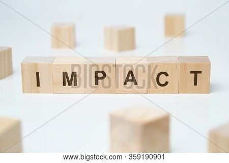 Modern Business Buzzword - Impact. Word On Wooden Blocks On A White Background. Close Up.