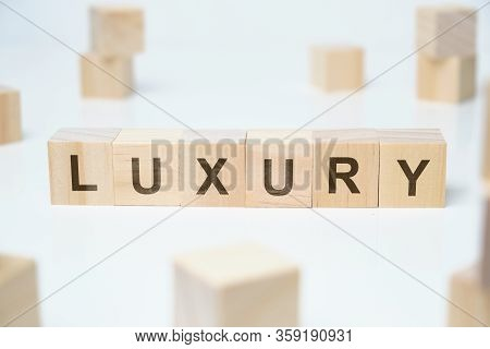 Modern Business Buzzword - Luxury. Word On Wooden Blocks On A White Background. Close Up.