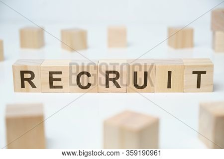 Modern Business Buzzword - Recruit. Word On Wooden Blocks On A White Background. Close Up.