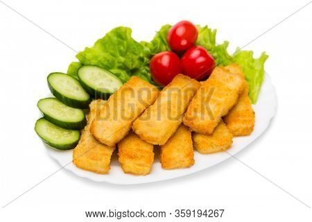 Grilled fish fingers with vegetables. Isolated on white.