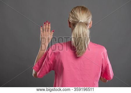 Back View Of Young Attractive Female Nurse Taking Oath