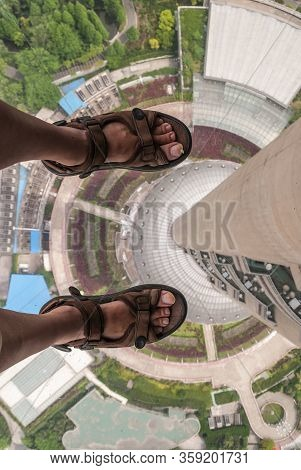 Shanghai, Pudong, Lujiazui, China - May 4, 2010: Looking Straight Down Along Shaft From Glass Floor