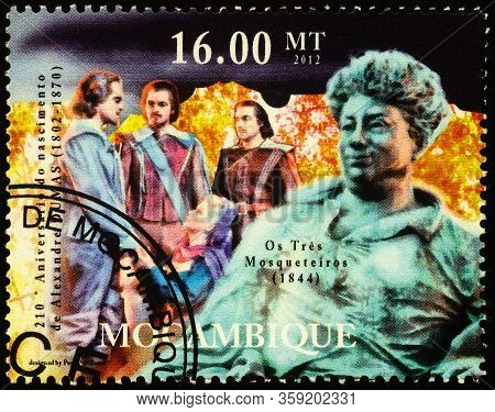 Moscow, Russia - April 01, 2020: Stamp Printed In Mozambique Shows Portrait Of Alexandre Dumas (1802