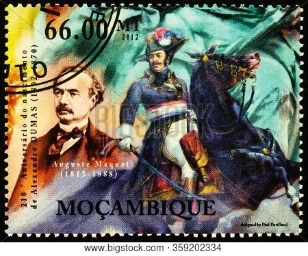 Moscow, Russia - April 01, 2020: Stamp Printed In Mozambique Shows Portrait Of Auguste Maquet (1813-