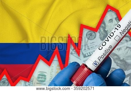 Coronavirus In Colombia. Positive Blood Test On Flag Background. Increase In Incidence. Economic Cri