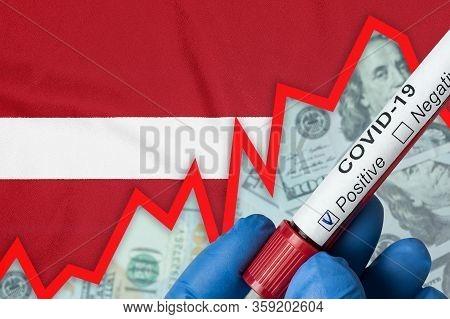 Coronavirus In Latvia. Positive Blood Test On Flag Background. Increase In Incidence. Economic Crisi
