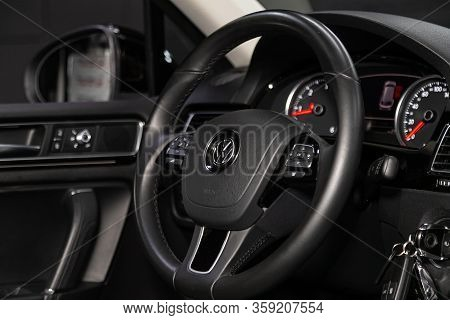 Novosibirsk, Russia - February 09 , 2020 Volkswagen Touareg, Auto Interior: Steering Wheel With Logo