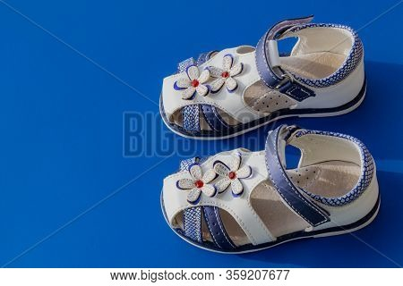 Childrens White Orthopedic Sandals On A Blue Background. Copy Space, Orthopedic Comfortable Shoes. S