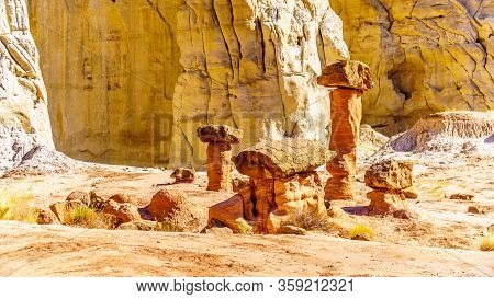 Toadstool Hoodoos against the background of the colorful sandstone mountains on the Toadstool Hiking