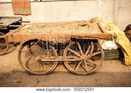 Old Indian cart. Vegetable trader arba at a market in Delhi, India.