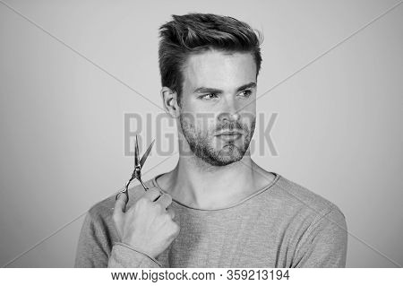 Fresh Hairstyle. Barbershop Concept. Barbershop Salon. Personal Stylist. Bearded Man Hold Scissors.