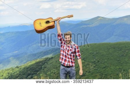 Hipster Musician. Hiking Song. Man Musician With Guitar On Top Mountain. Inspired Musician. Inspirin