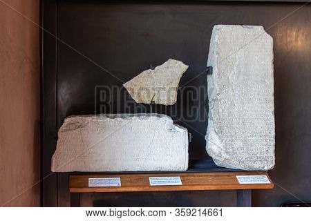 Verona, Italy - September 26, 2015 : Stone Fragments With Engraved Texts  At An Exhibition In The Mu