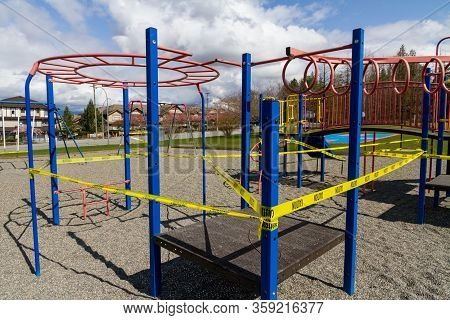 A Playground Is Caution Taped Off And Closed Due To Covid-19