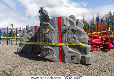 A Rock Wall In A Playground Is Closed Due To Covid-19 Prevention