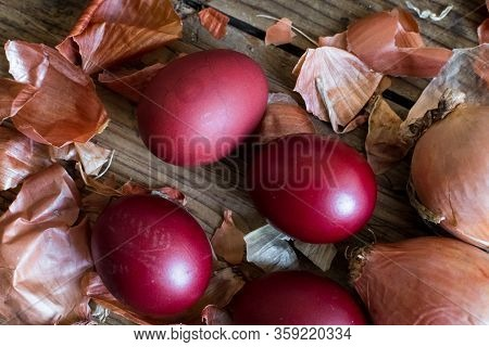Dyed Easter Eggs Painted With Natural Dye Onion On Rustic Wooden Background. Process Of Dyeing Eggs