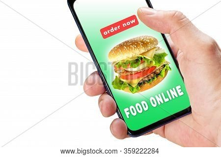 Hand Holding Phone With App Ordering And Delivery Food On Screen Isolated On White Background. Onlin