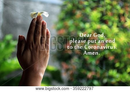 Dear God, Please Put An End To The Coronavirus. Amen. With Young Woman Clenched Hands Holding Flower