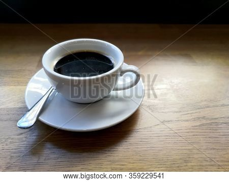 Delicious Cup Of Coffee On The Wooden Table.